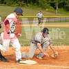 The Alexandria Aces first baseman on the rigth,  does his best with a bad throw from the outfield while Colin Shaw (17) tag the base first.