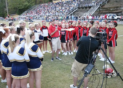 Cheerleaders for Perry Central and Hazard assist WYMT's meteorologist Jim Caldwell in giving the game forecast
