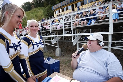 Hazard cheerleaders interviewed by radio announcer Ira Combs of WSGS during the pre-game show.