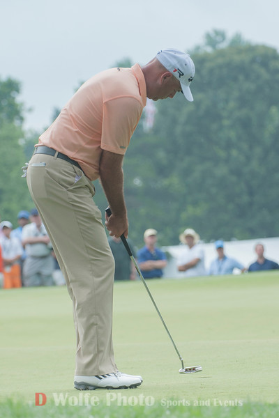 Stewart Cink putts his ball in on the 9th hole for a birdie.