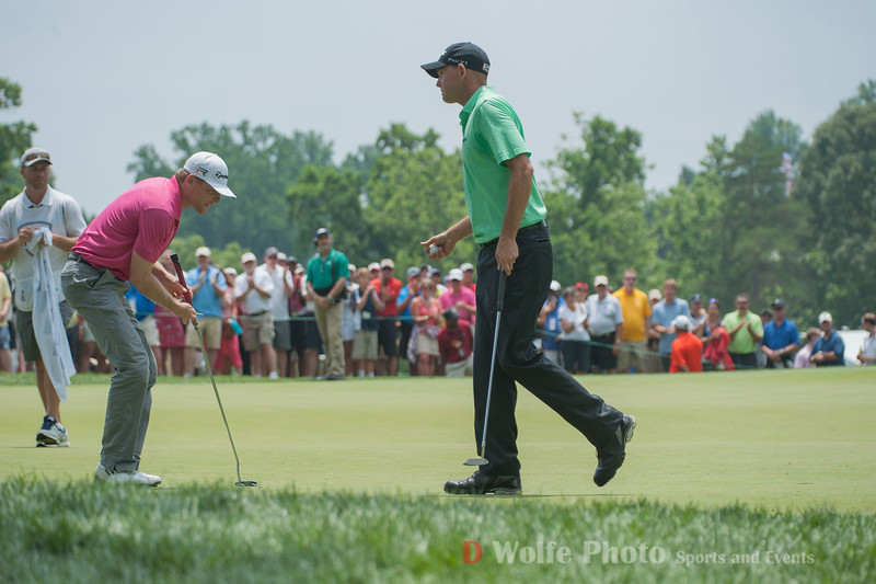 Bill Haas and James Driscoll on the 9th green.