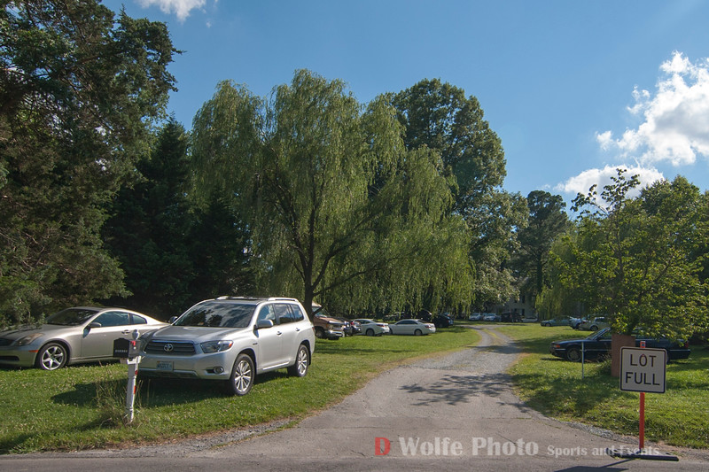 Parking on the lawns of private residences near Congressional Country Club.