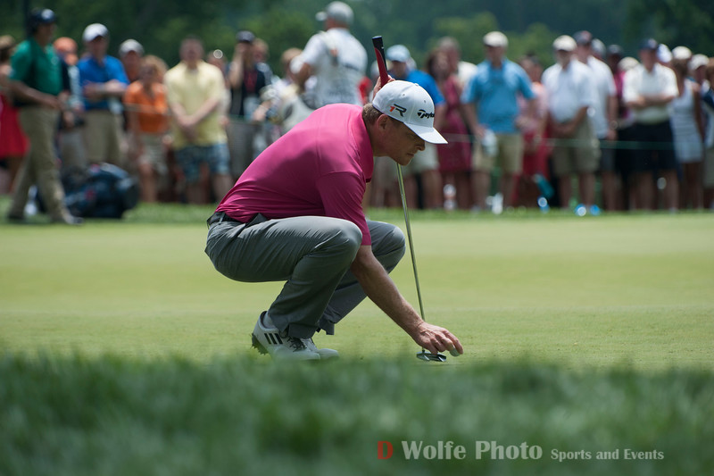 James Driscoll setting his ball for his putt on the 9th green.  He bogied this hole.