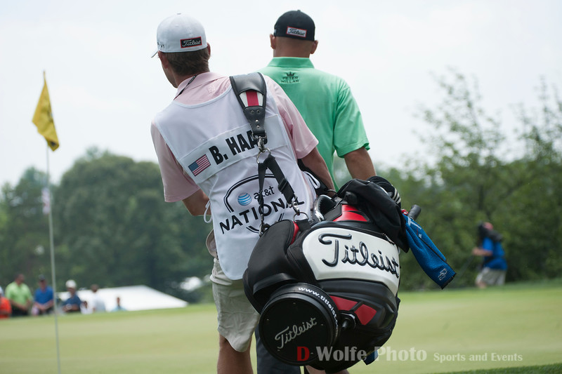 Bill Haas and his caddy studying the lie of Bill's ball on the green.
