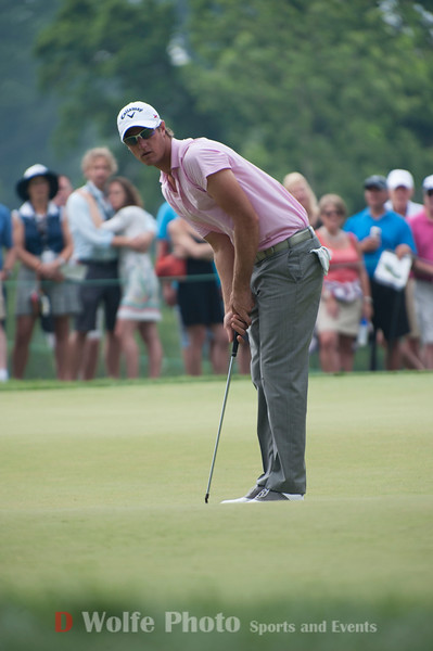 Nicolas Colsaerts sizing up his putt on the 9th hole.  He sank the putt for par in the 4th round of the 2013 AT&T National Tournament.
