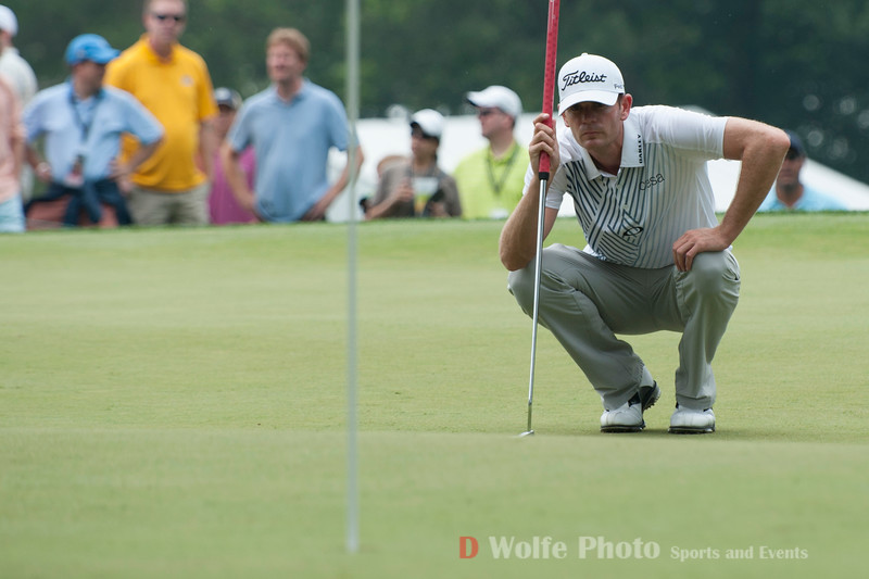 Morgan Hoffman sizes up his line for his final putt on the 9th green.