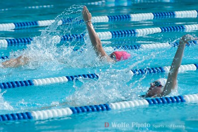In the pink cap, the back stroke leader shows excellent technical form on her stroke technique.