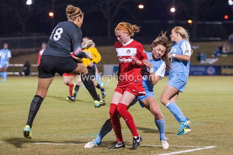 Tori Huster the Captain for the Spirit slammed on the brakes blocking two UNC players from crossing into the goalie box giving Chantel Jones, the goalkeeper time to clear the ball back to midfield.
