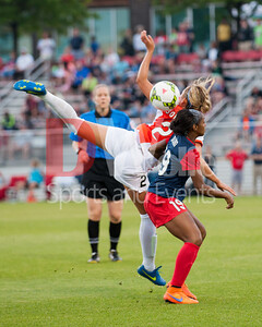 Crystal Dunn and Shawna Gordon tangle up looking for the ball win.