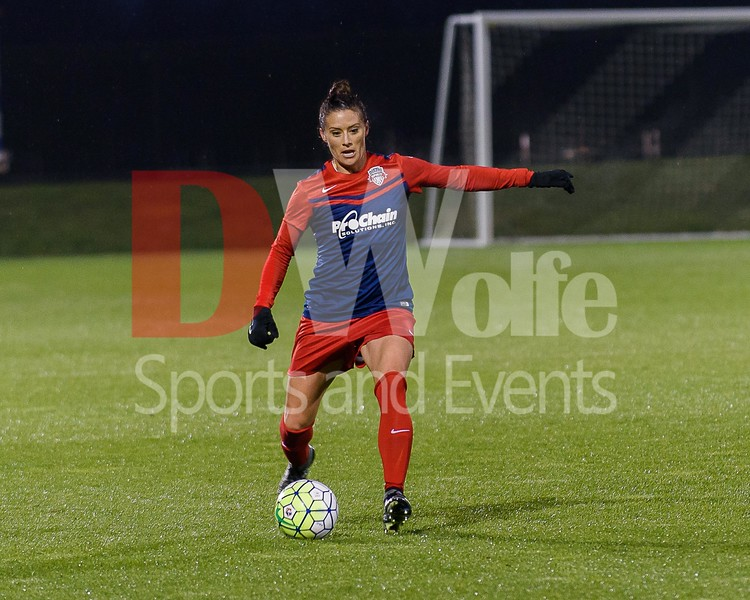 Spirit defender Ali Krieger clears the ball from the back field.