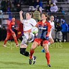 Megan Reid of UVA get a leg on the ball before forward Katie Stengel can win the ball.
