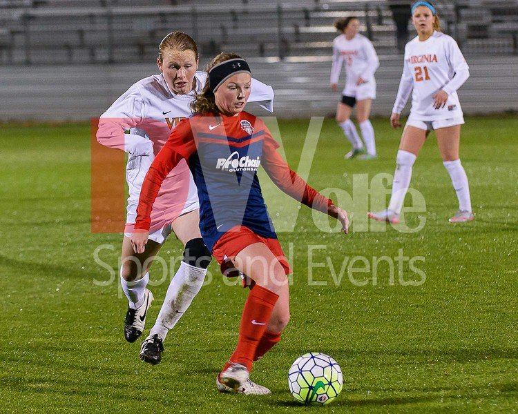 Midfielder Ali Murphy passes the ball on before any UVA players can take it away from her.