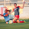 Spirit defender Alyssa Kleiner goes to the ground with Sky Blue defender and USWNT member Kelly O'Hara.