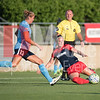 Spirit midfielder Christine Nairn tackles the ball away from Sky Blue player Kristin Grubka