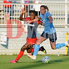 Francisca Ordega, forward for the Spirit battles with Sky Blue defender Christine Rampone.