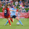 Spirit forward Estefania Banini nutmegs Sky Blue defender Erni Simon.