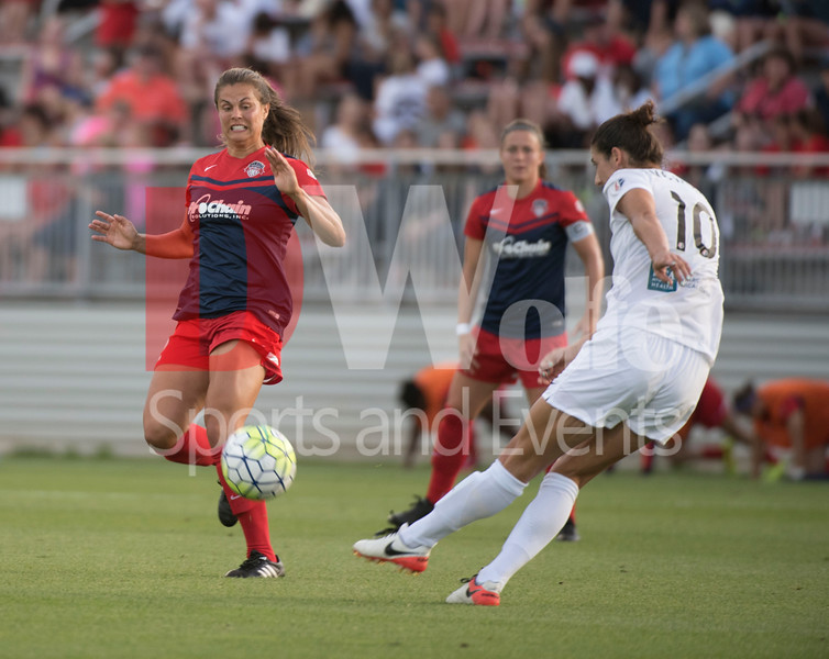 Forward Katie Stegel braces for possible impact off the boot of former Spirit player and now playing a leading role for FCKC Yael Averbuch.