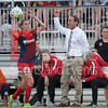 As Spirit defender Alyssa Kleiner returns the ball to play from the sideline, Head Coach and General Manager for the Spirit provides direction for other Spirit players to step up the pace.