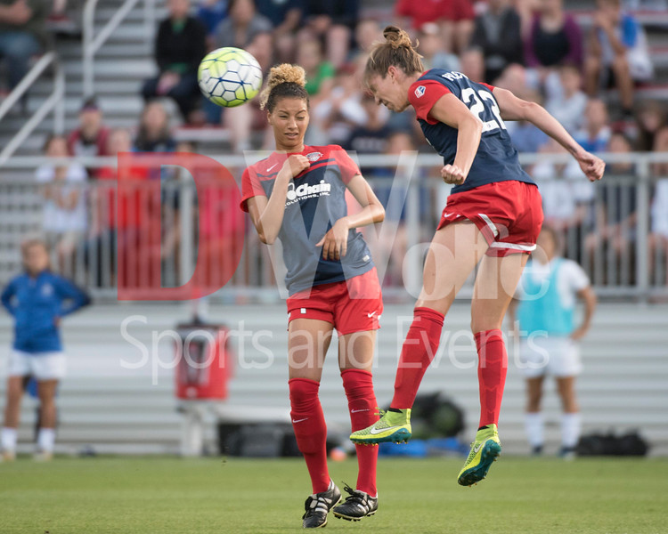 Spirit defender Alyssa Kleiner clears the ball out of the backfield using her head.