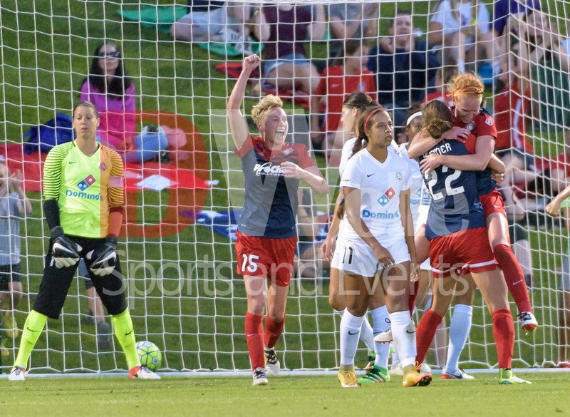 The celebration by teh Washington Spirit after Tori Huster scores a goal.   Tori is on the far right  in the arms of fellow team mate Alyssa Kleiner.