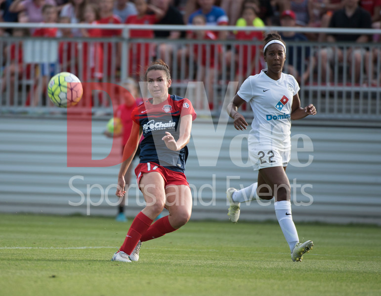 Cali Farquharson snaps off a shot towards the net as FCKC player  Brianne Reed can only watch.