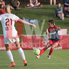 Spirit defender Caprice Dydasco clears the ball away from the backline.