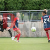 The ball gets past the keeper Kelsey Wys who ha dcome off her line, past Spirit  defender Caprice Dydesko and behind Estelle Johnson.  The loose ball was quickly recovered and cleared by Megan Oyster (not shown).