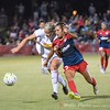 Spirit defender Caprice Dydesco chases down the ball.