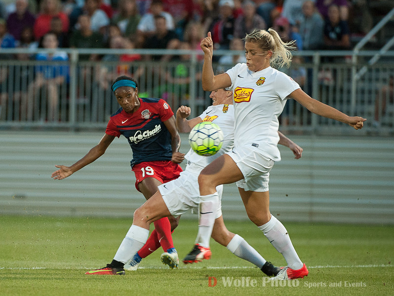 Even with 2 people marking Crystal Dunn, she gets off her shot on goal.  The shot went over the top of the frame.