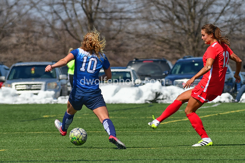 Katie Stengal gets a pass off beyond the reach of Emily Ogle's stride.