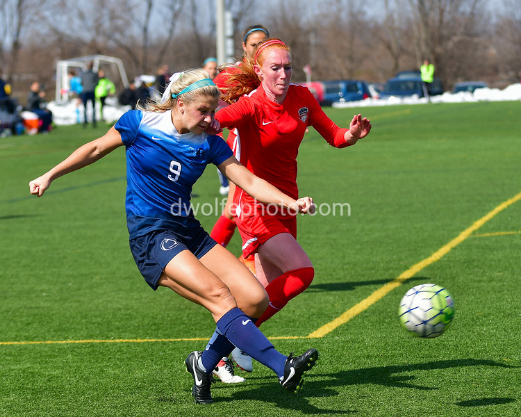 Frannie Crouse (9)  a forward with Penn State snap shots a pass before the Spirit's midfielder Tori Huster can block her path.