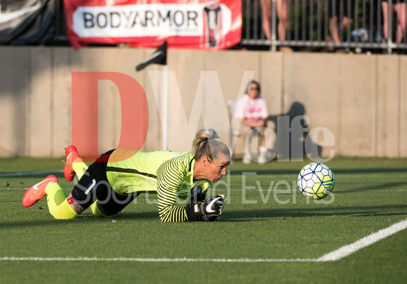 Pride keeper Ashlyn Harris keeping her focus on the ball after it got away from her.