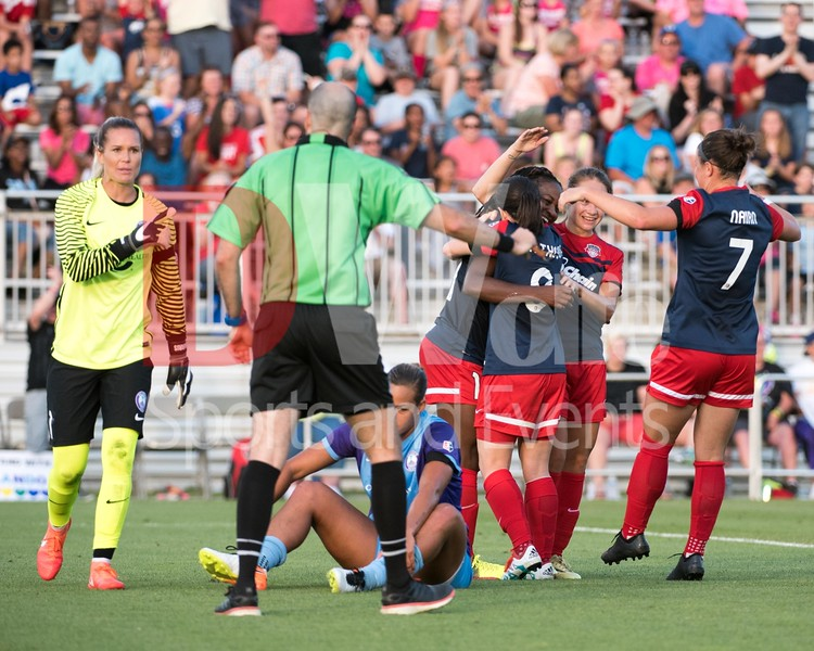 As the Washington Spirit celebrate Ordega's goal, Pride Keeper Ashlyn Harris is sharing her opinion of the play with the referee.