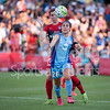 Orlando Pride's Samantha Witteman gets between the ball and defender Alyssa Kleiner for the Washington Spirit to head the ball away from Kleiner.