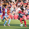Spirit forward Crystal Dunn turns the ball reversing direction leaving Orlando Pride defender Kristen Edmonds momentum  headed in the wrong direction to keep up.