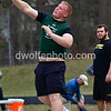 Walter Johnson's Andrew Birgin taking the shot that put him in second place overall in the boys shotput.   Watching closely in the background is the winner of the boys shotput, Breny Boyer from Northeast High School.  9th Annual Screaming Eagles Invitational.  Photos by David Wolfe ©