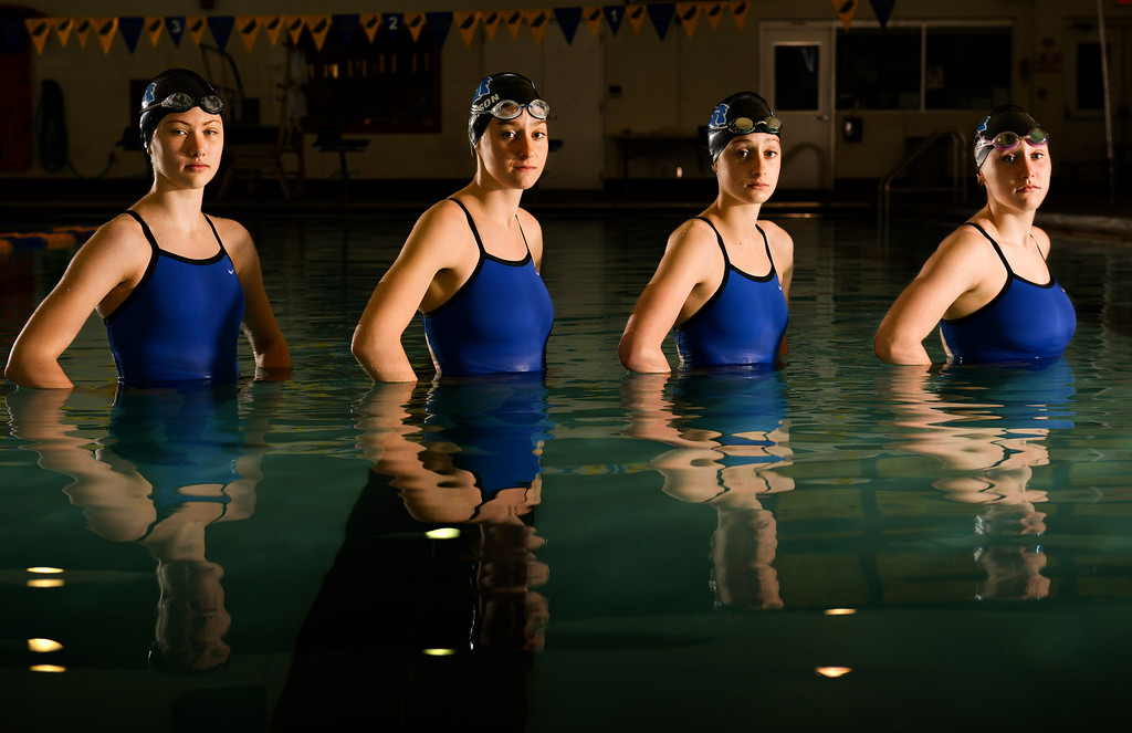 Justin Sheely | The Sheridan Press<br /> The Sheridan High School girls relay team, from left, Piper Carroll, Pippin Robison, Zoe Robison and Molly Green pose for a photo in the pool at Sheridan Junior High School. The four swimmers are this year's Fall Sports Female Athletes of the Year. The girls won the 200-yard medley relay at state this year.