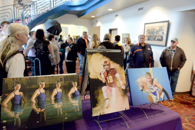 Justin Sheely | The Sheridan Press<br /> Guests visit in the lobby during The Sheridan Press' inaugural Sports Awards Ceremony Tuesday at the WYO Theater. The event recognized athletes and their achievements from high schools and the community college in Sheridan County.
