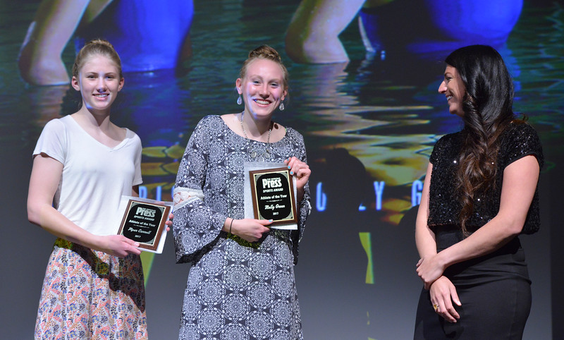 Justin Sheely   The Sheridan Press<br /> Sheridan High School Swimmers Piper Carroll, left, and Molly Green are presented with the Female Athletes of the Year Award along with Pippin Robison and Zoe Robison (not pictured) during The Sheridan Press' inaugural Sports Awards Ceremony Saturday at the WYO Theater.