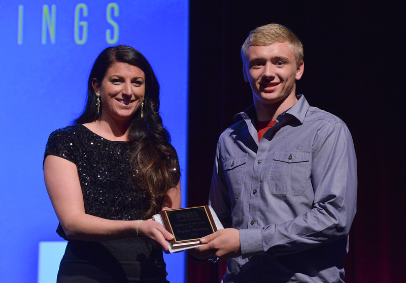 Justin Sheely   The Sheridan Press<br /> Chelsea Coli of The Sheridan Press presents Sheridan High School Bronc wrestler Hayden Hastings with the Male Athlete of the Year Award during The Sheridan Press' inaugural Sports Awards Ceremony Saturday at the WYO Theater.