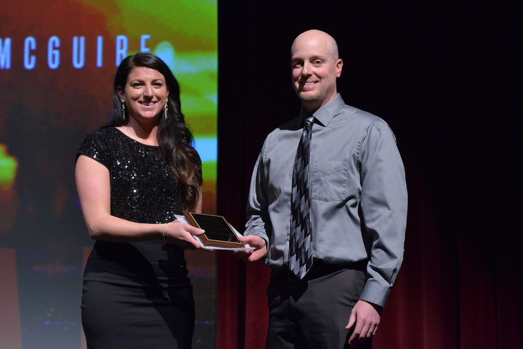 Justin Sheely   The Sheridan Press<br /> Reporter Chelsea Coli presents Big Horn football and girls basketball coach Michael McGuire with the Coach of the Year Award during The Sheridan Press' inaugural Sports Awards Ceremony Saturday at the WYO Theater.