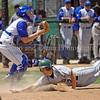 Carroll Tommy Avers slides into home for a Carroll run in the second playoff game against Hebron.
