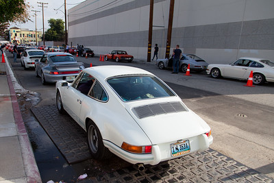 Porsches line up on both side of the street for the 2016 Luftgekühlt.
