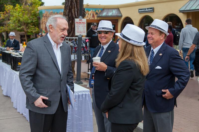 Event organizer, Douglas Freedman talks with a few of the event judges.