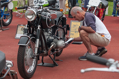 Tom Armstrong cleans off a few spots on his 1966 BMW R69S.