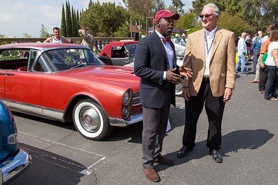 """""""What's My Car Worth"""" TV show host Donald Osborne interviews Mark Morgan about the 1960 Facel-Vega Excellence (background)"""