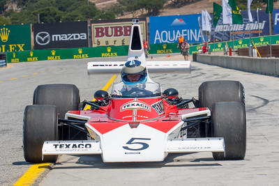 Formula 1 champion, Mika Häkkinen brings the 1974 world championship-winning McLaren M23 down pit lane after his exhibition run at the Rolex Monterey Motorsports Reunion