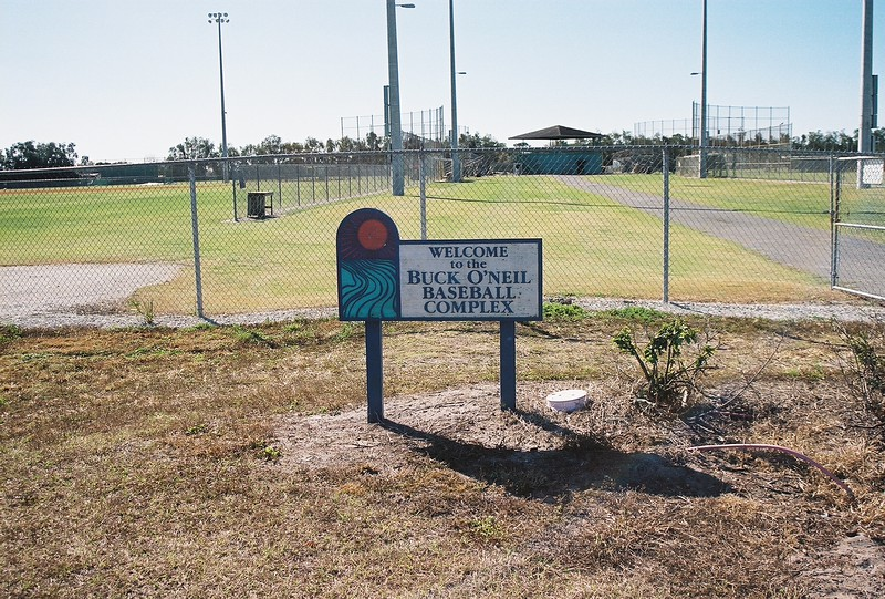 Date:  2/4/09<br /> Location:  Sarasota, FL<br /> The sign at the entrance to the practice fields at the Orioles Minor League Facility at Twin Lakes Park, Sarasota, FL...the Orioles renamed the facility in Buck O'Neil's honor in 1995