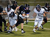 Byron Nelson quarterback Andrew Mitchell breaks through the Raider's line in the Bobcats' 38-31 victory over Wylie East last Friday night at NISD Stadium.