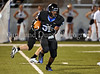Byron Nelson running back Carlos Lowe carries the ball in the Bobcats' 38-31 victory over Wylie East last Friday night at NISD Stadium.
